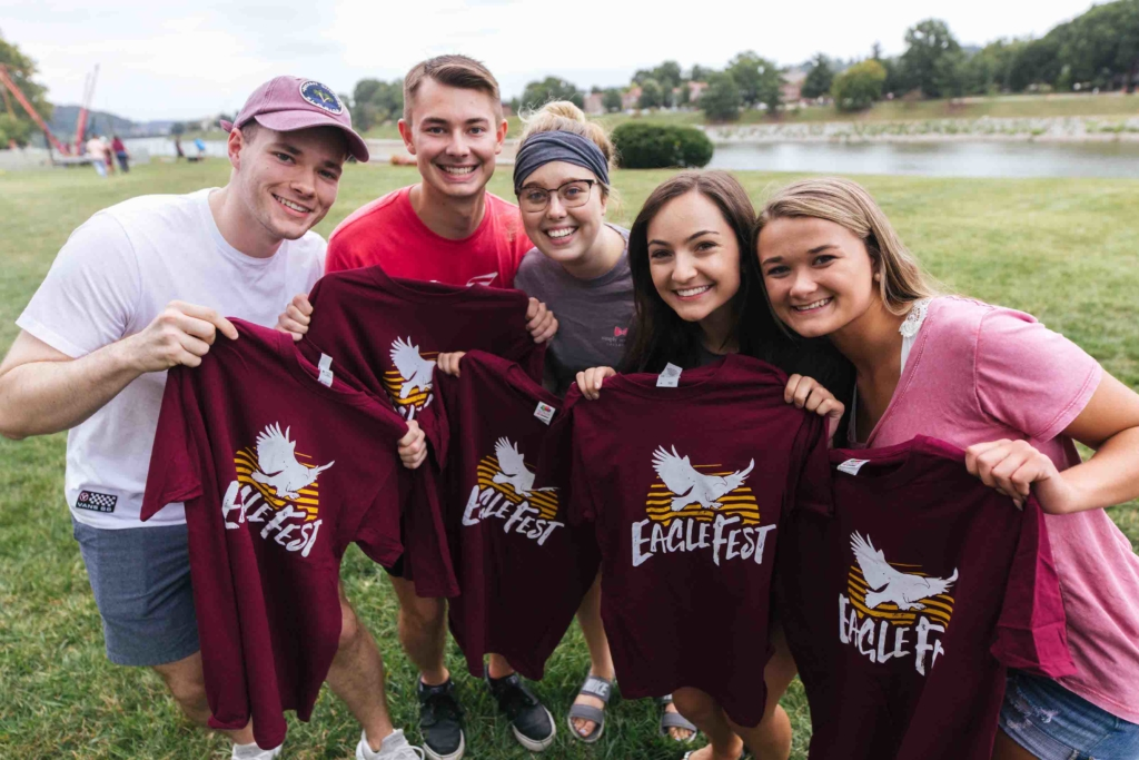 group of students posing with EagleFest t-shirts