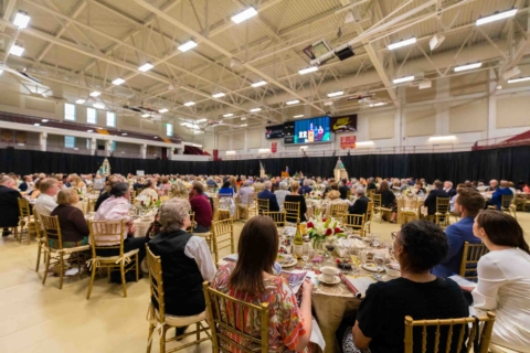back view of dinner event inside the basketball arena