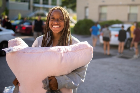 female student smiling during move-in day
