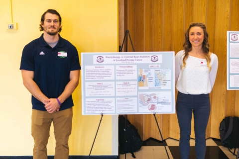 male and female physician assistant students standing with their research poster at the Innovation Showcase