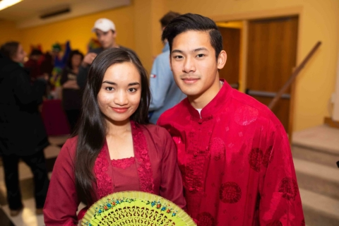 Students posing in traditional dress at international event