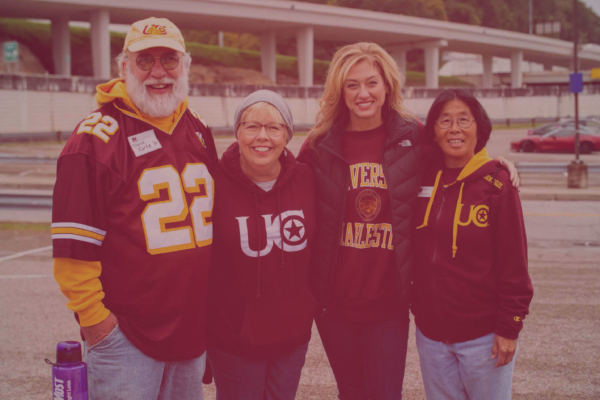 Group of alumni in UC apparel