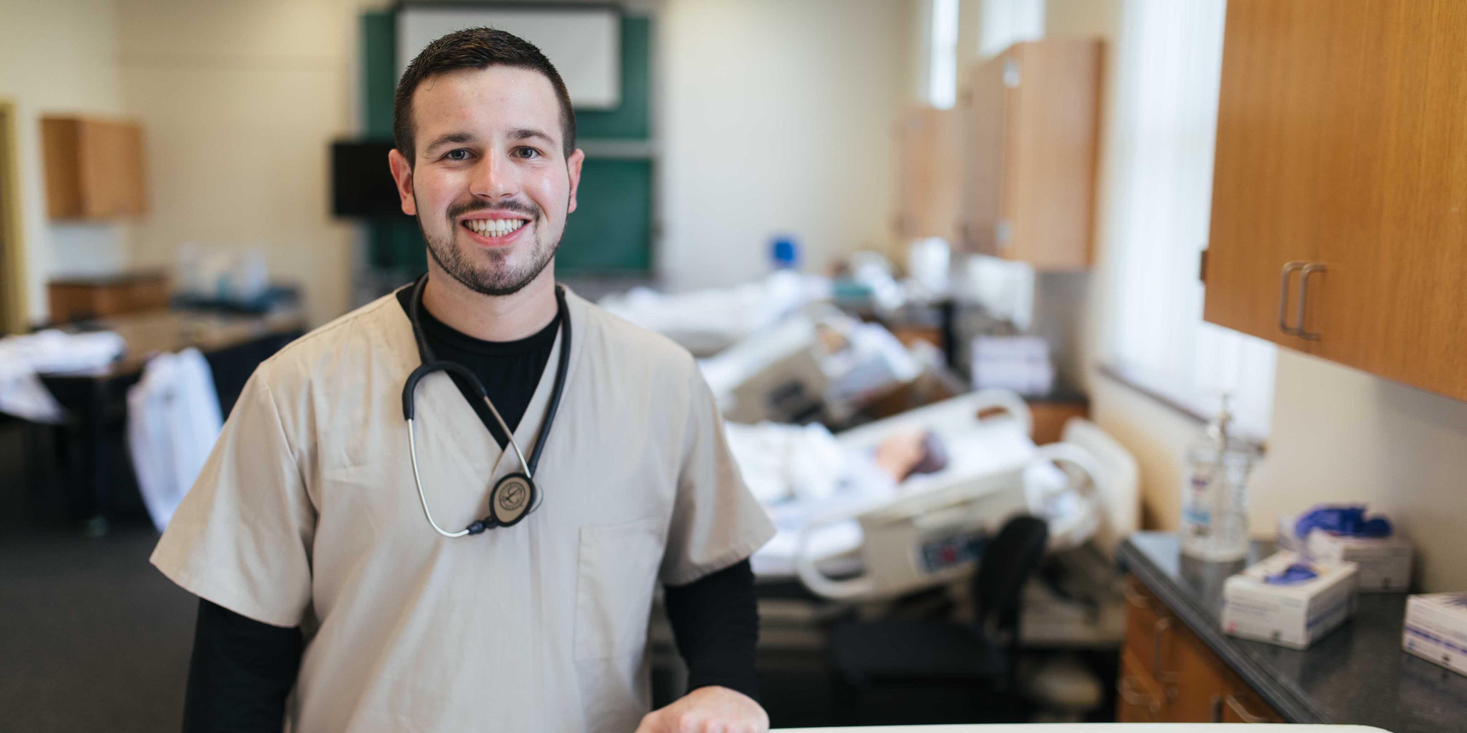 Nursing student in scrubs in simulation lab