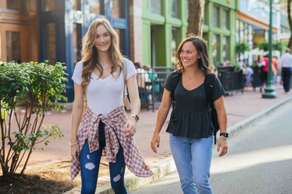 two female students walking down capitol street