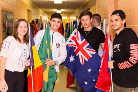 International students posing with international flags