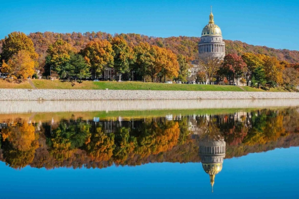 Capitol Dome reflected on river in fall