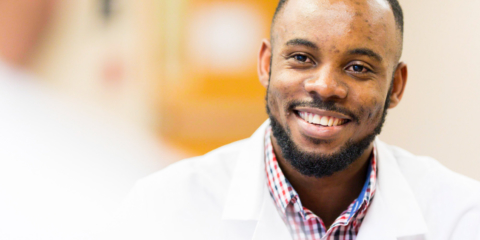 smiling male pharmacy student